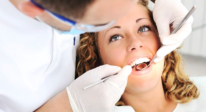 teeth whitening cost checkup