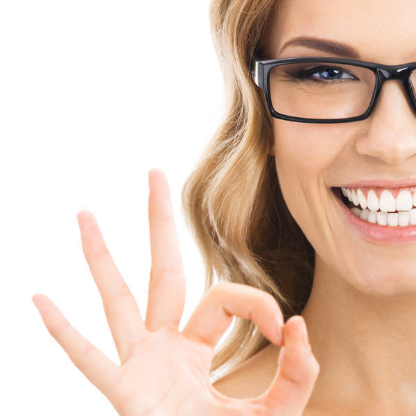 Lady smiling doing peace sign with black glasses