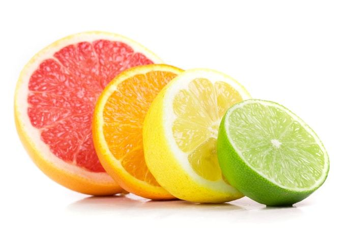 Fruits cut in half lime, lemon, orange and grapefruit.